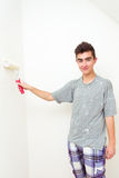 Teenager painting wall to white at home Royalty Free Stock Photography