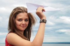 Teenager and paper plane Stock Image