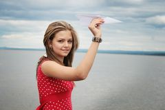 Teenager and paper plane Stock Photos