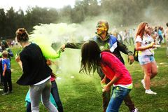 Teenager participate at Holi Fest. MOSCOW - SEPTEMBER 6, 2014: Unidentified teenagers at the Color Holi Fest on September 2014 in Moscow, Russia. Roots of this stock images