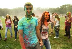 Teenager participate at Holi Fest. MOSCOW - SEPTEMBER 6, 2014: Unidentified teenagers at the Color Holi Fest on September 2014 in Moscow, Russia. Roots of this stock photography