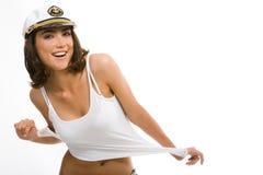 Teenager with peak-cap. Portrait of beautiful teenager with peak-cap on her head touching a white t-shirt Royalty Free Stock Photo