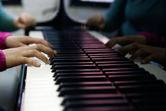Teenager performing on a piano Stock Photos