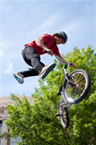 Teenager Performs Midair Stunt In Pro BMX Bike Competition. Athens, GA, USA - April 25, 2015:  Teenager performs midair stunt in the pro BMX competition at the Royalty Free Stock Photos
