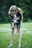 Teenager with pet dog. Teenage girl holding Bernese Mountain dog puppy in arms stock images