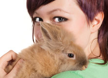 Teenager with pet rabbit. Attractive teenager girl with her brown bunny rabbit Stock Images