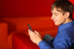 Teenager with phone. Smiling teenager in the room with mobile phone Stock Photos