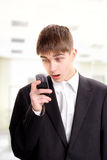 Teenager with phone Royalty Free Stock Image