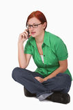 Teenager on the phone. Image of a redheaded teenager girl using a mobile phone.Shot with Canon 70-200mm f/2.8L IS USM stock photo