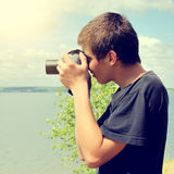 Teenager with Photo Camera Royalty Free Stock Photo