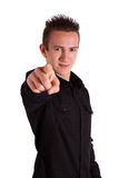 Teenager picks you. A handsome teenager points at the viewer. All isolated on white background Stock Photos