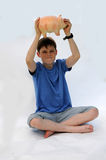 Teenager with piggy bank Stock Image