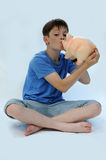 Teenager with piggy bank Stock Photography