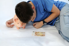 Teenager with piggy bank Royalty Free Stock Photos