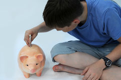 Teenager with piggy bank Royalty Free Stock Images