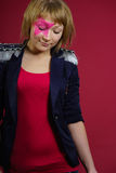 Teenager with pink star on the face Royalty Free Stock Images