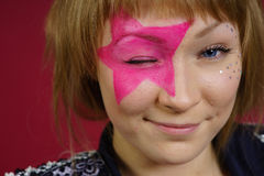 Teenager with pink star on the face Royalty Free Stock Photography