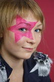 Teenager with pink star on the face Royalty Free Stock Photos