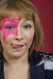 Teenager with pink star on the face Stock Photo