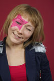 Teenager with pink star on the face Royalty Free Stock Photo