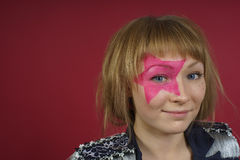 Teenager with pink star on the face Royalty Free Stock Image