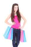 Teenager in pink t-shirt with shopping bags Stock Photos