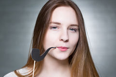 Teenager with pipe prop. Teenager with long hair and pipe prop royalty free stock photo