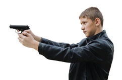 Teenager with a pistol Royalty Free Stock Photo
