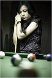 Teenager play billiard. Stock Photos