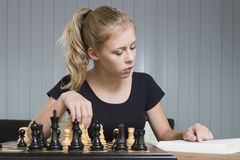 Teenager play chess Stock Photography