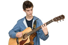 Teenager playing acoustic guitar. On white background Royalty Free Stock Image