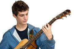 Teenager playing acoustic guitar. On white background Royalty Free Stock Photo