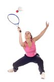 Teenager playing badminton. Young woman playing badminton isolated on white Stock Images