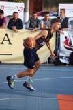 Teenager playing basketball Stock Image