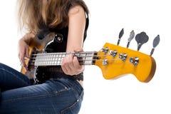 Teenager playing on bass guitar Stock Image