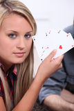 Teenager with playing cards Stock Images