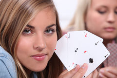 Teenager playing cards Stock Image