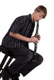 Teenager playing the clarinet Stock Photography