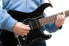 Teenager playing electric guitar. On white background Royalty Free Stock Images
