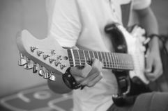 Teenager playing electric guitar in the street. Closeup of teenager playing electric guitar in the street Royalty Free Stock Photos