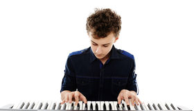 Teenager playing an electronic piano Royalty Free Stock Images