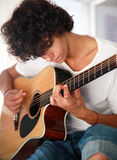 Teenager playing guitar. Closeup of teenage male playing acoustic guitar Stock Images