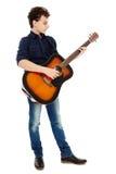 Teenager playing guitar. Teenage caucasian boy playing an acoustic guitar Stock Photos