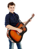 Teenager playing guitar. Teenage caucasian boy playing an acoustic guitar Stock Images
