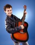 Teenager playing guitar. Teenage caucasian boy playing an acoustic guitar Royalty Free Stock Photo