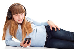 Teenager playing with mobile Stock Images