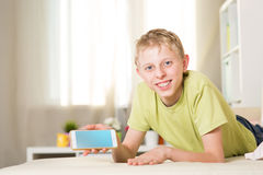 Teenager is playing in the phone royalty free stock photo