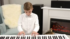 Teenager Playing a Piano Partiture. Teenager practicing piano lesson at home