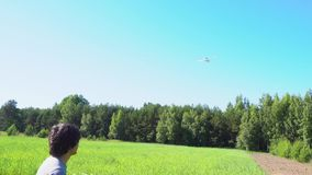Teenager with a plane. Teenager playing with a plane on summer lane stock video footage