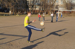Teenager playing soccer Royalty Free Stock Photo